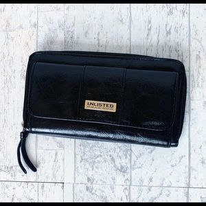 Unlisted black trifold wallet by Kenneth Cole